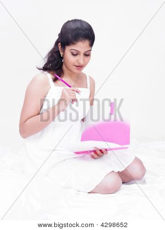 Asian Woman Holding A File And Pen
