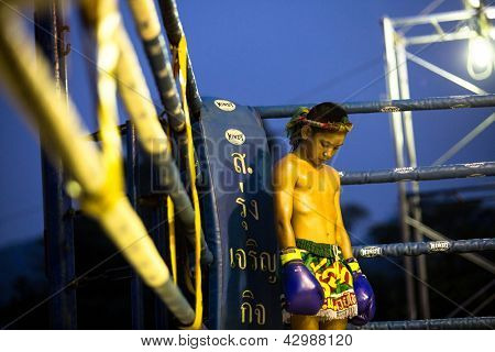 CHANG, THAILAND - FEB 22: Unidentified young Muaythai fighter in ring during match, Feb 22, 2013 on Chang, Thailand.For many Thai men, is only way to break out of poverty, per battle pay to 7000 baht.