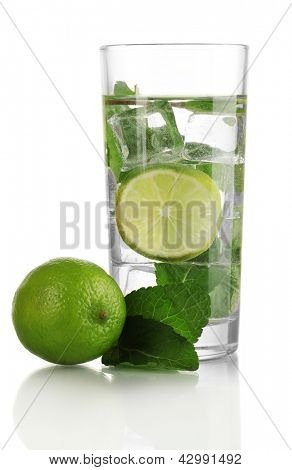 Glass of water with ice, mint and lime isolated on white