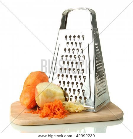 Metal grater and apple, carrot on cutting board, isolated on white
