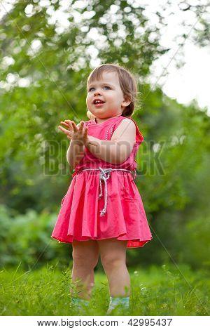 little girl stading on meadow