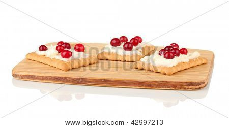 Cookie with cheese and cranberry, on cutting board, isolated on white