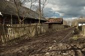 stock photo of stockade  - Dirt road passing through the small village - JPG