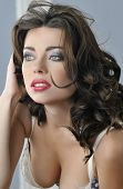 stock photo of nudity  - Portrait of blue eyed brunette looking pretty in Lingerie - JPG