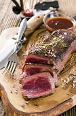 stock photo of ribeye steak  - beef steak on the wooden board - JPG
