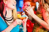 picture of bachelor party  - Young women in club or bar drinking cocktails and having fun - JPG