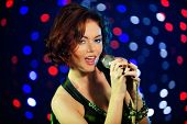 image of night-club  - Portrait of beautiful redhead female singer on stage - JPG