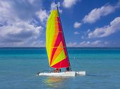 pic of pontoon boat  - Catamaran sail boat on turquoise waters with blue sky - JPG