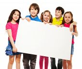 stock photo of placard  - Happy smiling group of kids friends boys and girls showing blank placard board to write it on your own text isolated on white background - JPG