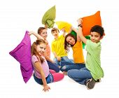 image of pillow-fight  - Happy five teen kids diversity looking boys and girls fighting with pillows laughing and having fun isolated on white - JPG