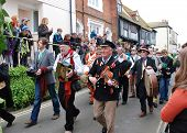 HASTINGS, ENGLAND - MAY 7: Musicians parade through the Old Town during the annual Jack In The Green
