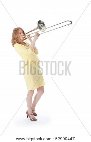 Young Woman In Yellow Mini Dress Playing The Trombone