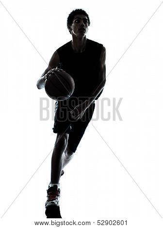 one young man basketball player dribbling silhouette in studio isolated on white background