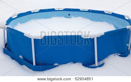Abandoned Swimming Pool At Winter, Surrounded With Snow