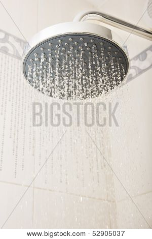 shower head with drops and streams of water