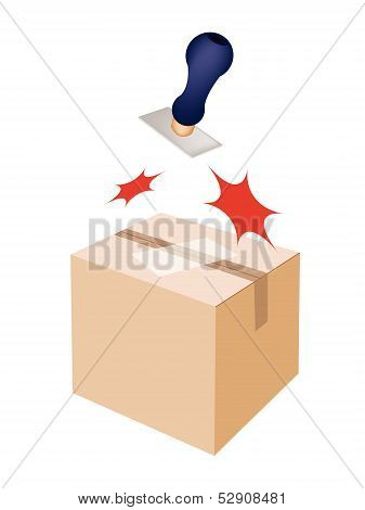 Rubber Stamp On A Brown Cardboard Box