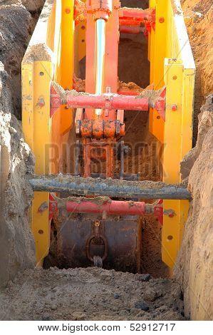 Digger Shovel Inside Ditch