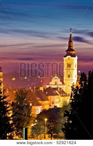 Church Tower In Colorful Dusk
