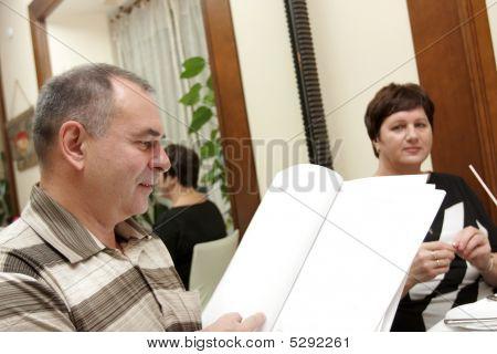 Man Reading Menu