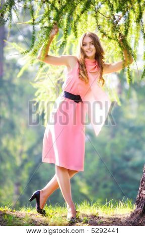 Young Happy Woman In Pink Dress