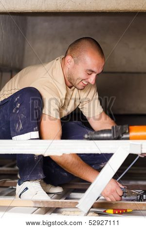 Handy Man Working With Cables