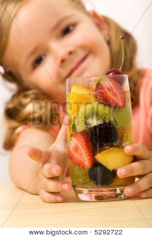 Happy Healthy Little Girl With Fruit Salad