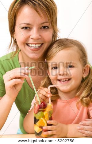 Woman And Little Girl Having A Fruity Refreshment
