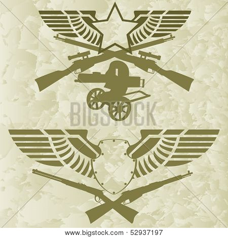 Badges with wings and firearms