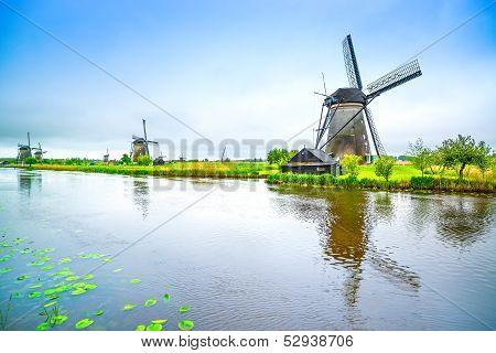 Windmills And Canal In Kinderdijk, Holland Or Netherlands. Unesco Site