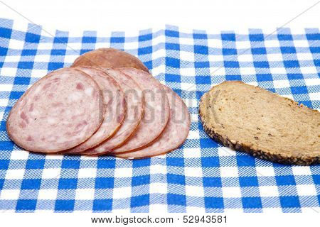 Head Cheese with Baked Brown Bread on Blue White Cloth