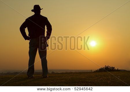 Cowboy gazing into the sunset