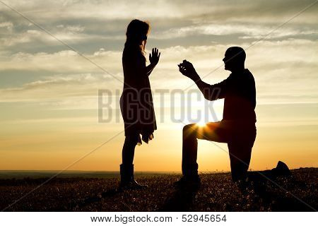 Romantic Sunset Marriage Proposal
