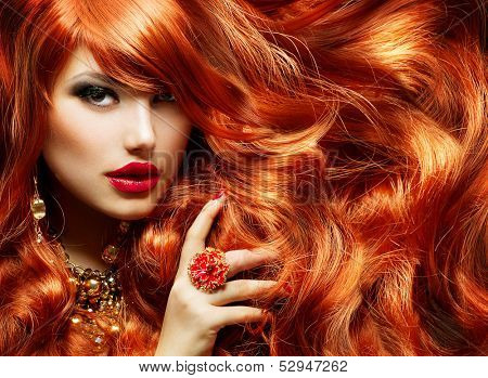 Long Curly Red Hair. Fashion Woman Portrait. Beauty Model Girl with Luxurious Hair, Make up and Acce poster