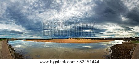 Early morning light, with dramatic cloud formations over Lossiemouth harbour, Moray Firth, Scotland