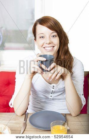 Beautiful Vivacious Woman Drinking Coffee