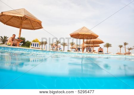 People Resting Near Swimming Pool