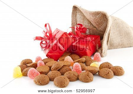 Typical Dutch Celebration: Sinterklaas With Surprises In Bag And Ginger Nuts