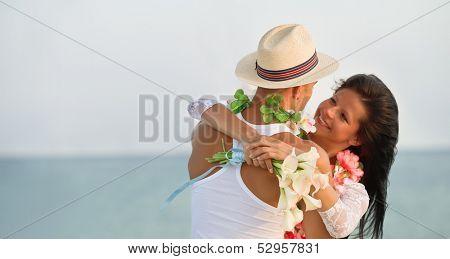 Groom with bride wearing lei