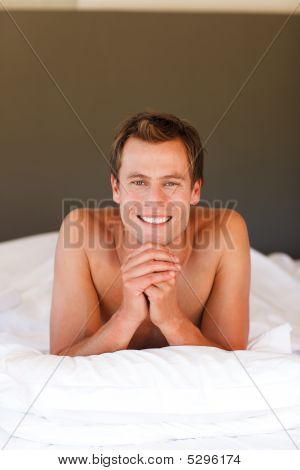 Smiling Handsome Boy Lying In Bed With Copy-space