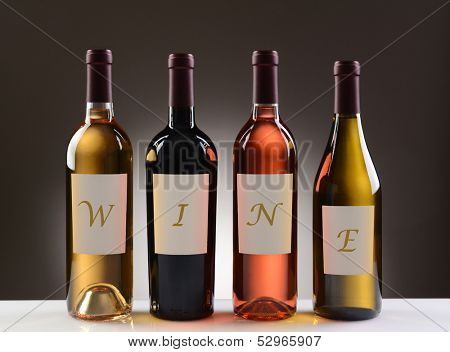 Four Wine Bottles with their labels spelling out the word WINE, on a light to dark gray background. Wines include: Cabernet Sauvignon, Chardonnay, Sauvignon Blanc, and White Zinfandel.
