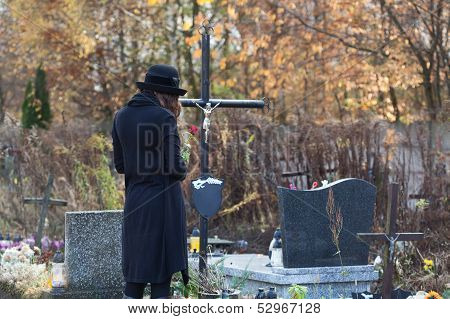 Woman In Mourning At Cemetery