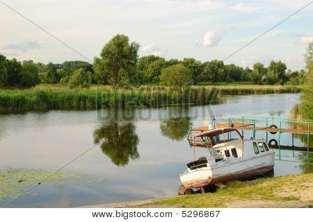 Ukrainian Rural Landscape With Old Rescue Motor Boat