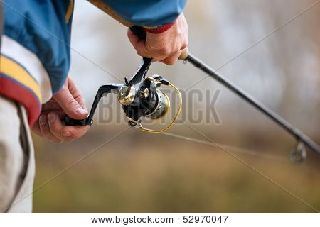 Fisherman`s Hands With Spinning.