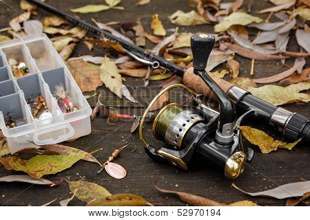 Fishing Tackle On Wooden Surface.