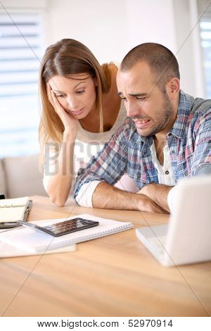 Couple being worried about their budget