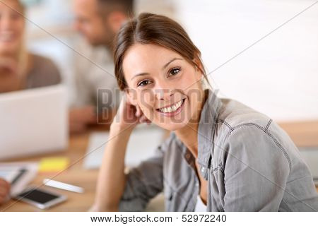 Young woman attending business training class