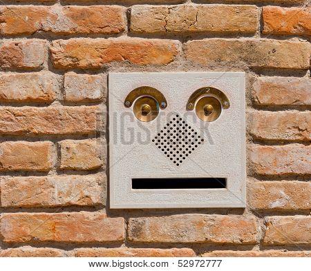 A Modern Intercom Doorbell  Panel On Old Brick Wall.