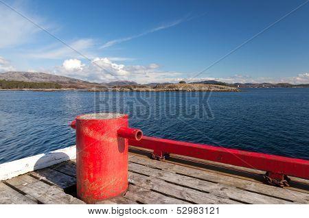 Red Mooring Bollard On Wooden Pier