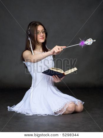 Girl - Sorcerer With The Book And A Magic Wand