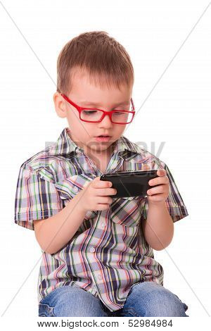 Clever Kid Is Playing With Smart Cell Phone